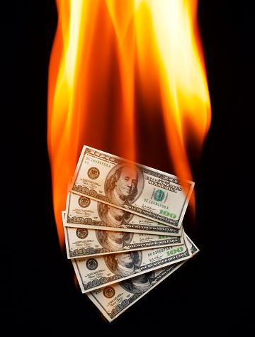 Economic fortune「US 100 dollar bank notes burning (digital composite)」:スマホ壁紙(6)