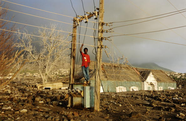 Overcast「Montserrat,Plymouth,man by power lines after volcanic eruption」:写真・画像(7)[壁紙.com]