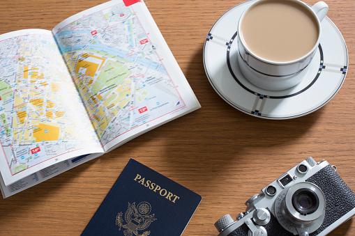 Guidebook「Passport, coffee, old camera and open guidebook」:スマホ壁紙(1)