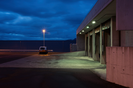 Parking Lot「Empty parking lot and cloudy sky at night」:スマホ壁紙(14)