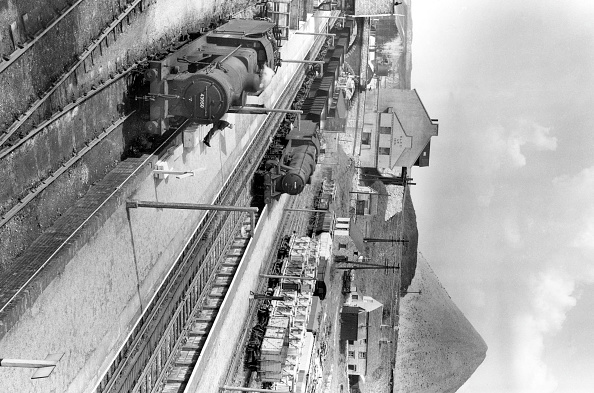 North「Peak Forrest station looking north is 36 miles from Derby on the Midland Railway's Manchester line. A train of limestone empties is on the main line with Stanier 8F No.48605 in charge」:写真・画像(13)[壁紙.com]