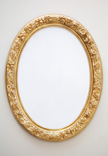 Gold Colored「Empty Antique Mirror in Gilt Oval Frame on Neutral Wall」:スマホ壁紙(5)