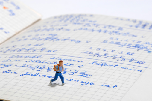 子供時代「Figurine of schoolboy on exercise book, close-up, high angle view」:スマホ壁紙(9)
