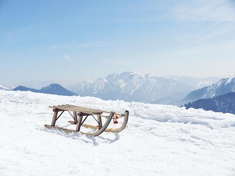 Snow sled「Germany, Tegernsee, sledge standing on Wallberg」:スマホ壁紙(0)