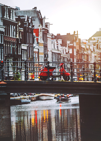 Amsterdam「Red scooter parked on a bridge in Amsterdam」:スマホ壁紙(19)