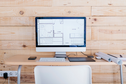 Computer Equipment「Desk in a home office with floor plan on the computer」:スマホ壁紙(13)