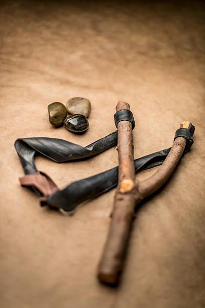 Antique slingshot with stones.:スマホ壁紙(壁紙.com)