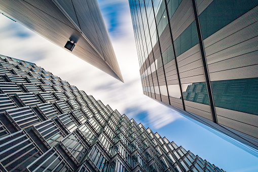 Brexit「Abstract low and wide angle view up towards modern Business buildings in London's Financial District - creative stock image」:スマホ壁紙(7)