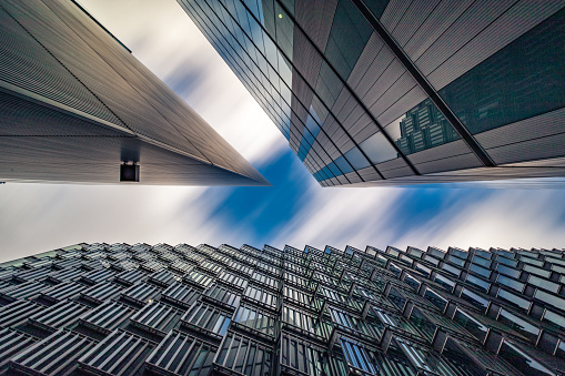 Brexit「Abstract low and wide angle view up towards modern Business buildings in London's Financial District - creative stock image」:スマホ壁紙(13)