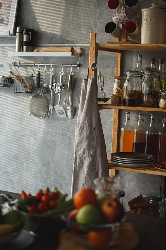 Apron「Kitchen shelves and kitchen utensils hanging on the wall」:スマホ壁紙(1)