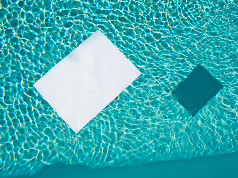 "Floating On Water「""FILL IN THE BLANK"". White piece of paper floating in a pool.」:スマホ壁紙(6)"