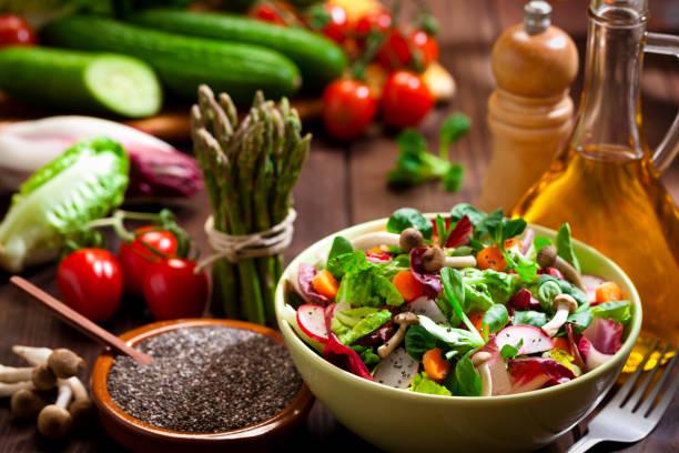 Preparing healthy salad with chia seeds on rustic wood table:スマホ壁紙(壁紙.com)