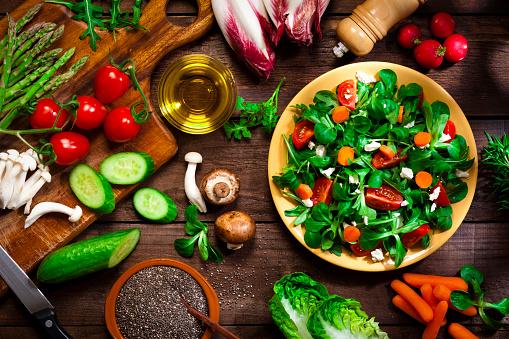 Organic「Preparing healthy salad with chia seeds on rustic wood table」:スマホ壁紙(17)