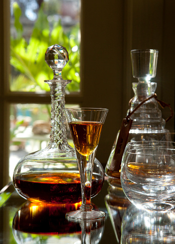 Bar - Drink Establishment「Antique crystal glass of brandy or port wine and a crystal decanter behind it in a elegant home bar or drink establishment—part of a series」:スマホ壁紙(4)