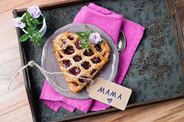 Heart-shaped cherry cake with name tag and flowers on tray:スマホ壁紙(壁紙.com)