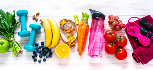 Exercising and healthy food: raibow colored fruits, vegetables and fitness items:スマホ壁紙(壁紙.com)