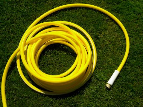 Hose「Coiled garden hose on grass, overhead view」:スマホ壁紙(0)