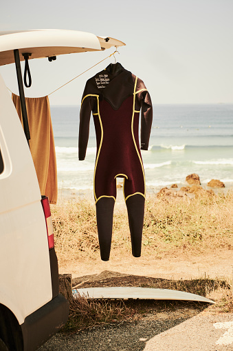 France「A surfer's camper van with a drying wetsuit hanging outside at the coast.」:スマホ壁紙(17)