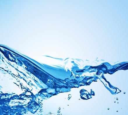Splashing「Water splashing on a blue background 」:スマホ壁紙(12)