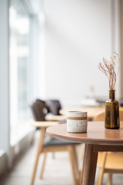 Coffee cup on top of wooden table next to window:スマホ壁紙(壁紙.com)