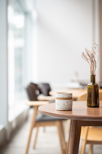 Decoration「Coffee cup on top of wooden table next to window」:スマホ壁紙(7)
