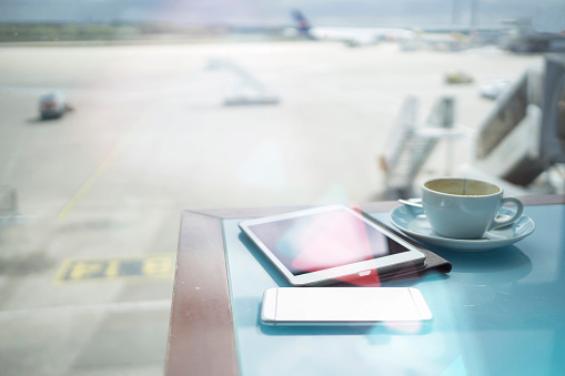 Portability「Coffee cup, smartphone and digital tablet on table at airport」:スマホ壁紙(17)
