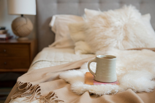 Coffee - Drink「Coffee cup and book on fur on bed」:スマホ壁紙(2)