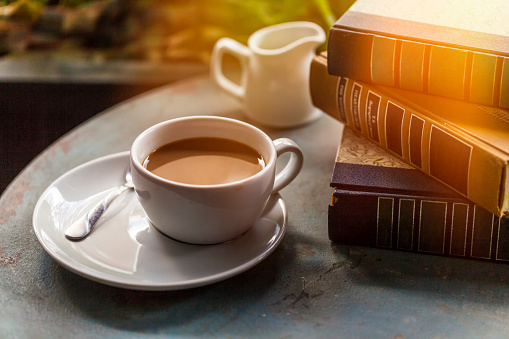 Breakfast「Coffee Cup and books on a wooden table」:スマホ壁紙(17)