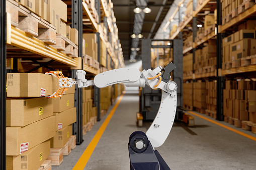 Hand「Robotic Arm Taking A Cardboard Box In The Warehouse」:スマホ壁紙(1)