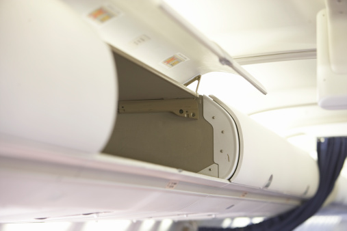 Passenger Cabin「Empty overhead baggage compartment on airplane」:スマホ壁紙(2)