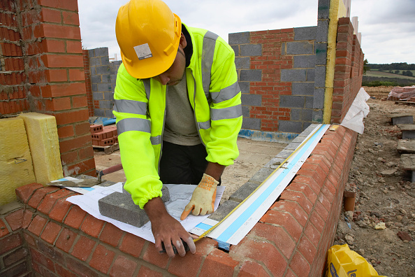 Construction Industry「Bricklayer looking at plans House building site, England, UK」:写真・画像(15)[壁紙.com]