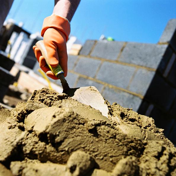 Brick Wall「Bricklayer applying cement onto bricks.」:写真・画像(8)[壁紙.com]