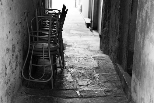 Piedmont - Italy「Chairs back lit in narrow italian alley」:スマホ壁紙(5)