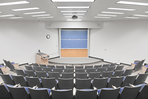 University「Empty university lecture hall with curved seating」:スマホ壁紙(17)