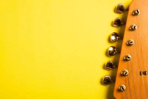 Tuning Peg「Guitar headstock on yellow」:スマホ壁紙(2)
