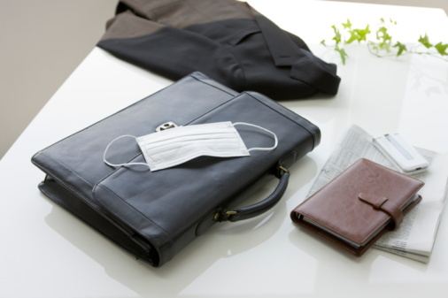 Briefcase「Surgical mask, briefcase and jacket on table」:スマホ壁紙(10)