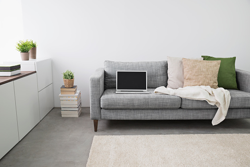 Blanket「Opened laptop on couch at modern living room」:スマホ壁紙(13)