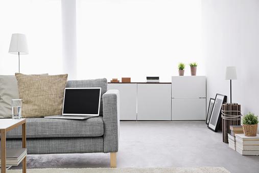 ソファ「Opened laptop on couch at modern living room」:スマホ壁紙(13)