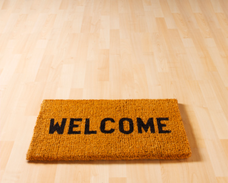 Rectangle「Welcome doormat on wooden floor, close-up, elevated view」:スマホ壁紙(2)