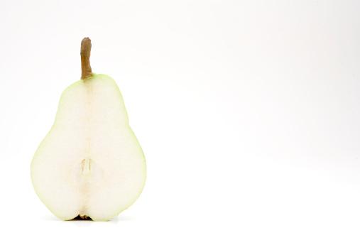 白梨「Pear (pyrus) cut in half on a white background」:スマホ壁紙(13)