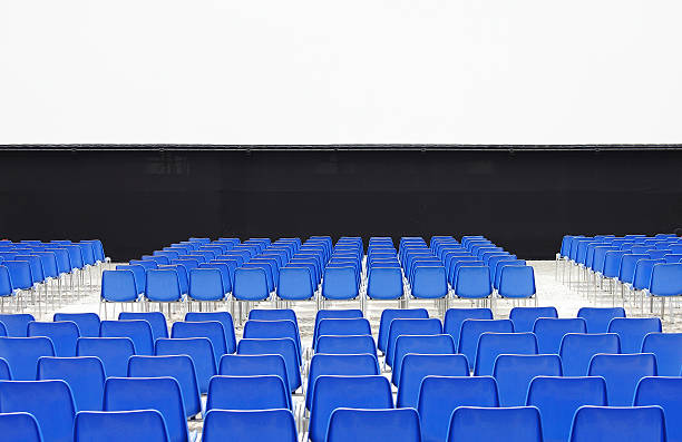 Outdoor cinema with blue chairs.:スマホ壁紙(壁紙.com)