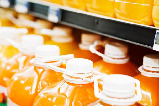 Refrigerated Section「Large bottles of orange juice in supermarket fridge」:スマホ壁紙(11)