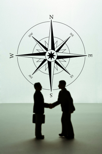 Well-dressed「Silhouette of businessmen figurines shaking hands, compass rose in background. (Focus on background)」:スマホ壁紙(8)