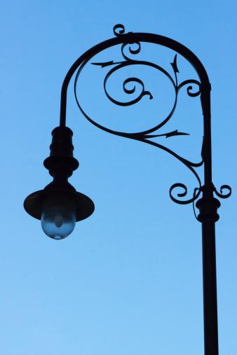 Gas Light「Silhouette of old street gas lamp against blue sky」:スマホ壁紙(8)