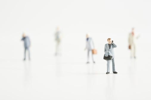 Figurine「Businessmen figurines standing on white ground.」:スマホ壁紙(14)