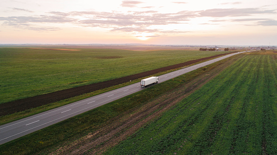 Pasture「Cargo trucks on the road in countryside in Ukraine」:スマホ壁紙(2)