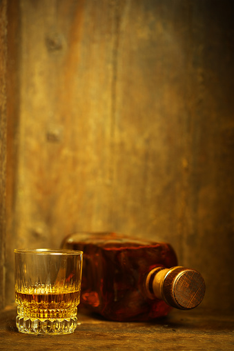 Belgium「A glass and a bottle of whiskey on wooden background」:スマホ壁紙(15)