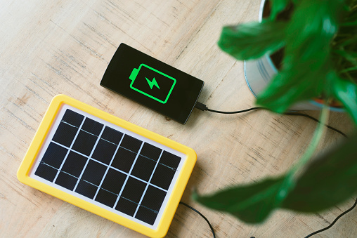 Solar Energy「Renewable energy technology, solar panel charging a mobile phone battery」:スマホ壁紙(6)