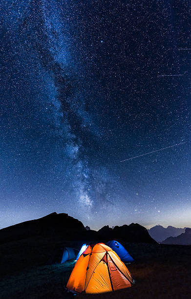 Italy, Dolomites, Milky Way over Monte Pelmo with tents of camp in the foreground:スマホ壁紙(壁紙.com)