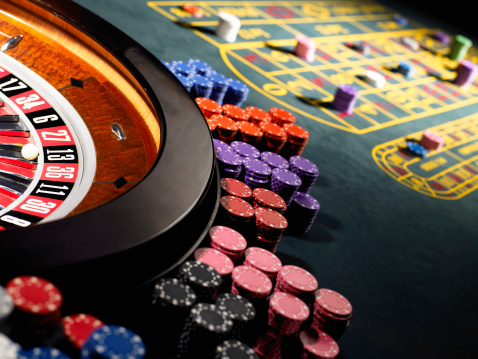 Leisure Games「Gambling chips stacked around roulette wheel on gaming table」:スマホ壁紙(3)